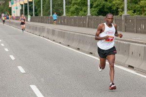 Kangogo en route to victory on the Burrard St. Bridge. Photo: Inge Johnson