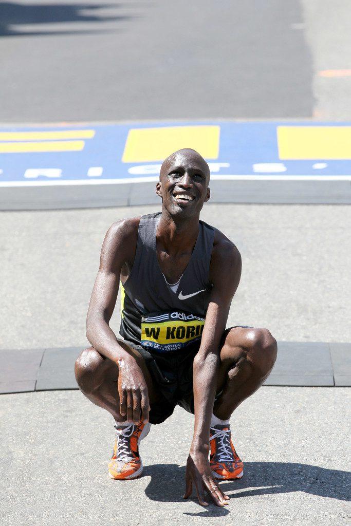 Wesley Korir touches the ground after winning the 2012 Boston Marathon Credit: photorun.net