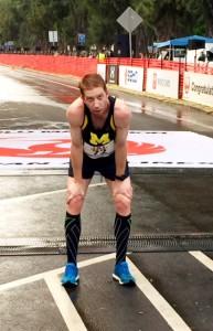 Kevin Sullivan, with hands to knees after finishing the 2014 Honolulu marathon. Photo: Tonireavis.com