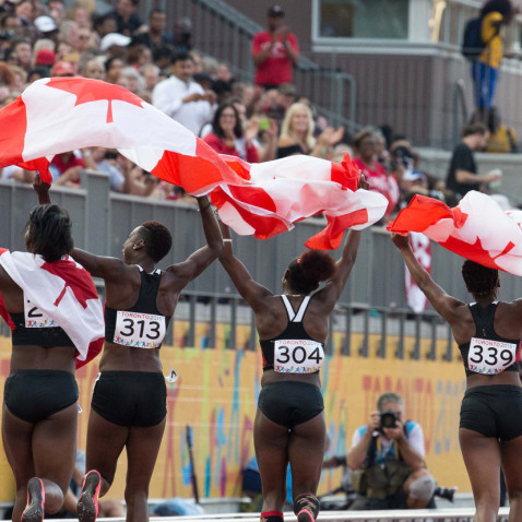 The Canadian women's 4x100m relay team celebrates their bronze medal.