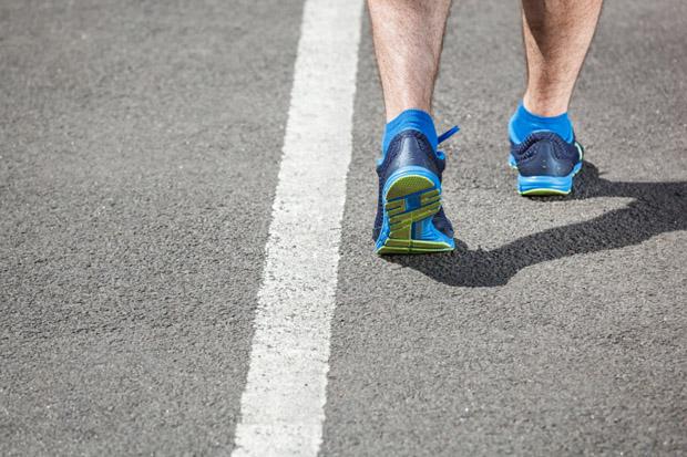 Runner feet running - closeup on shoe.