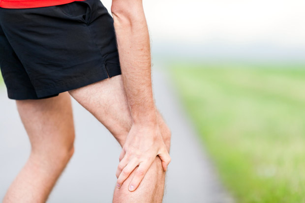 Runner leg and muscle pain during running training outdoors