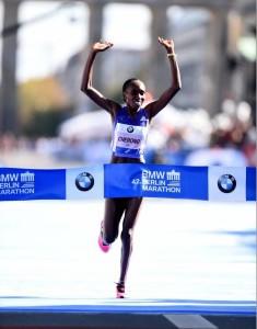 Cherono winning the Berlin Marathon.