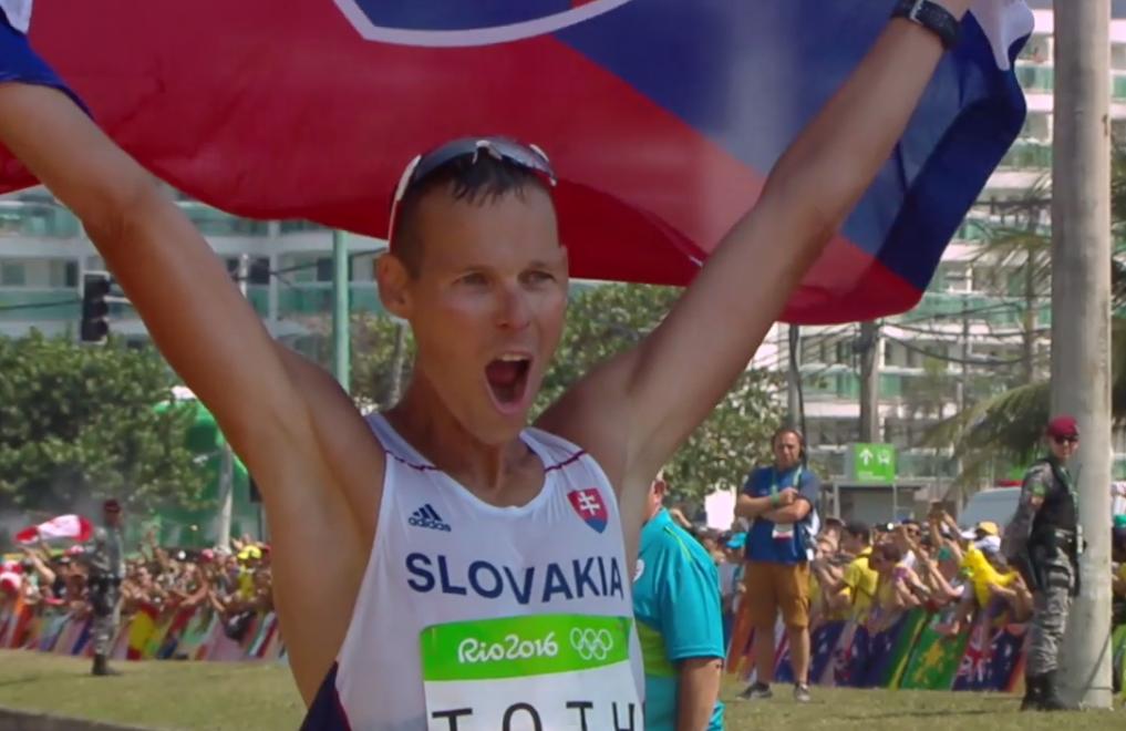 Matej Toth celebrating after a brisk morning stroll ends in a gold medal