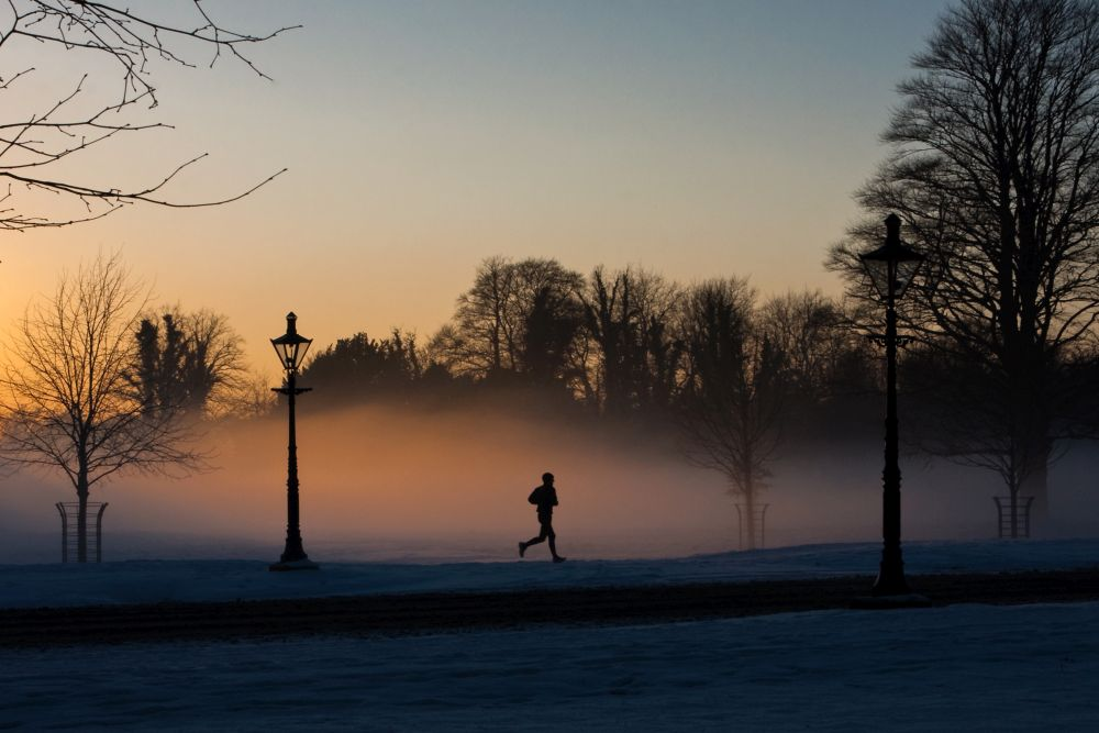 A runner in the misty Phoenix park.