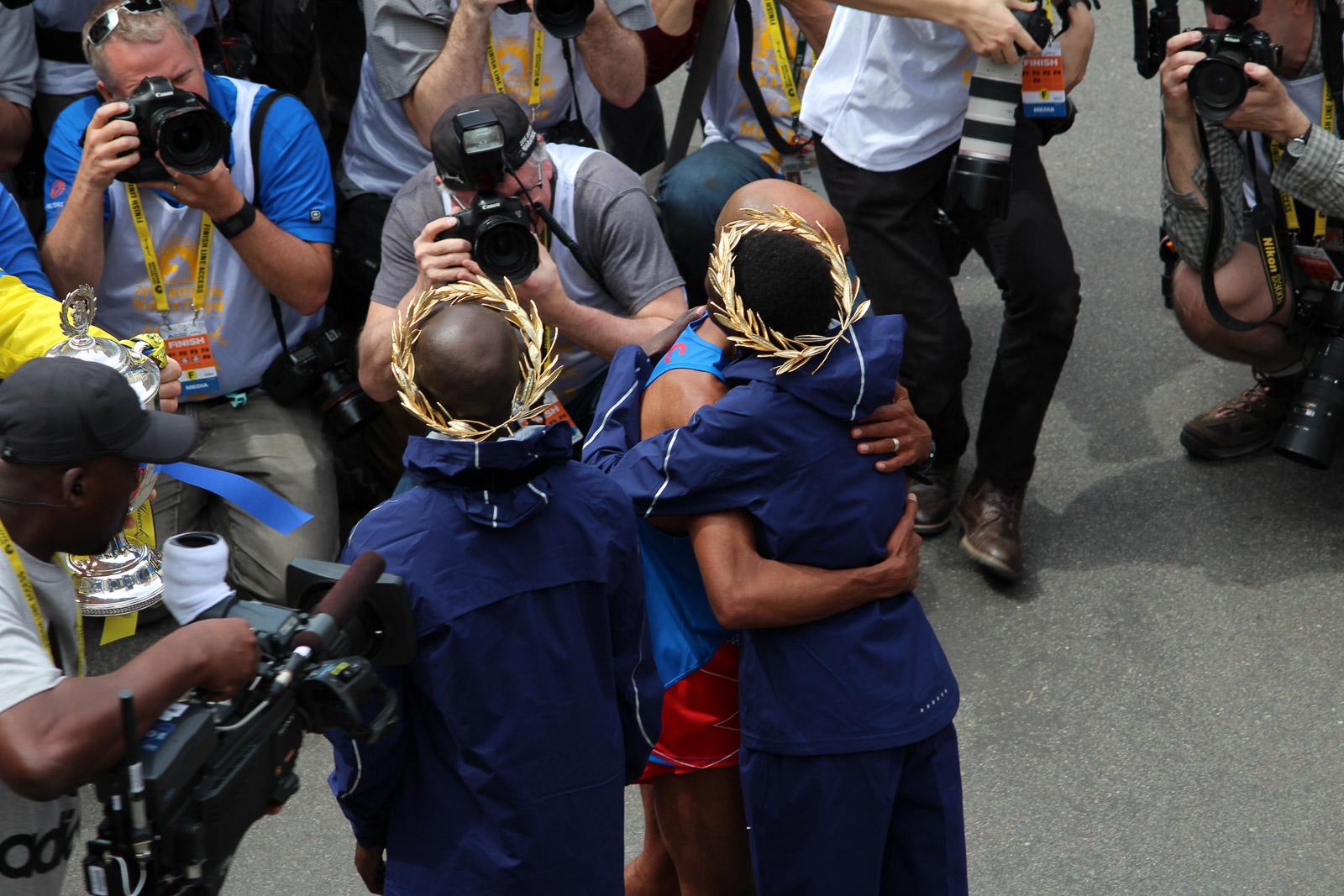 Meb hugs both winners of the Boston Marathon. Photo: Michael Doyle