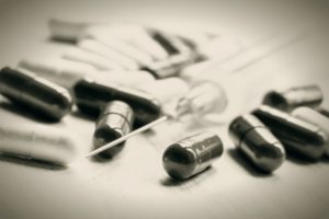 Black and white photo. Drug in capsules